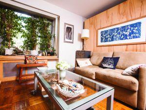 The designer's living room. (Photo: Emily Assiran for Observer)