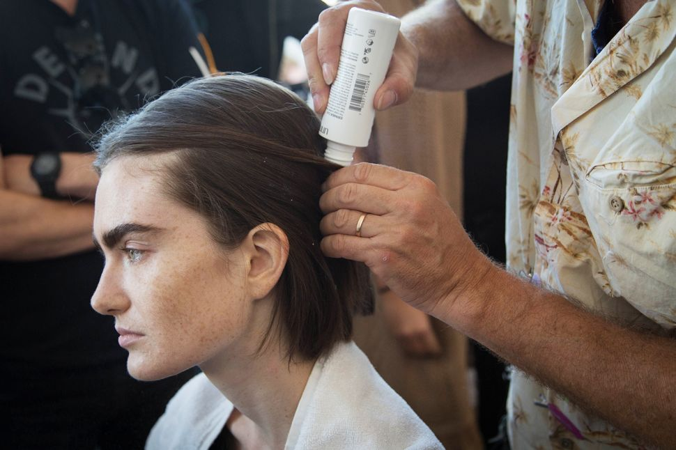 Photo Essay: A Star Hair Stylist Works His Magic Backstage at Fashion Week