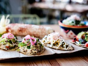Tostadas de salpicon de atun, tlacoyo and tlayuda Oaxaquena at Rosie's. (Photo: Chris Sorensen/For New York Observer)