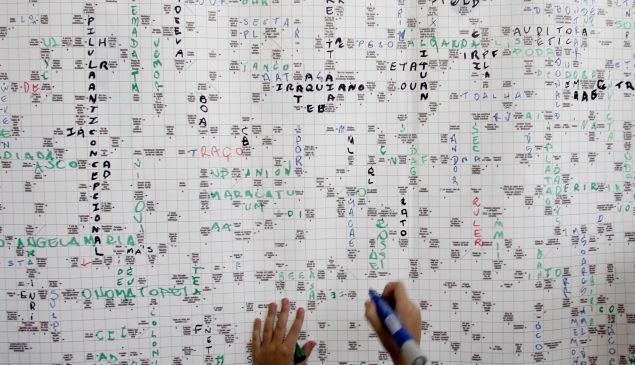 Sao Paulo, BRAZIL: A child enjoys a huge crossword puzzle made of 16.000 small squares and more than 3.200 questions as part of the launching of the 19th International Book Fair, in Sao Paulo, Brazil, 09 March 2006. Supported by The Guinness Book office in London, the crossword measuring 3,25 meters high by 1,30 meters long, has become the world's biggest. AFP PHOTO/Mauricio LIMA (Photo credit should read MAURICIO LIMA/AFP/Getty Images)