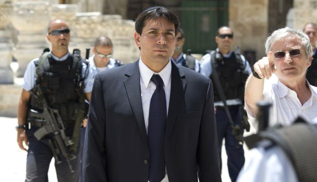 Surrounded by security Deputy Speaker of the Israeli parliament, Danny Danon is taken on a tour of the Temple Mount or Al-Aqsa Mosque Compound the holy site for Judaism and the Islam in Israeli annexed east Jerusalem's old City July 20, 2010, during the 9th of Av day of mourning for the destruction of the First and Second holy temples. AFP PHOTO/AHMAD GHARABLI (Photo credit should read AHMAD GHARABLI/AFP/Getty Images)