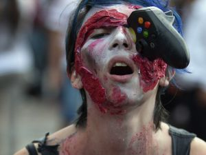 """A woman dressed up as zombie takes part in a """"Zombie Walk"""" in Mexico City on November 23, 2013. According to organizers, 10,000 people are taking part in the event. AFP PHOTO/Alfredo Estrella (Photo credit should read ALFREDO ESTRELLA/AFP/Getty Images)"""
