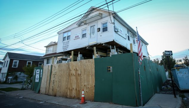 A home being elevated in Staten Island to comply with flood maps, pictured in 2014, two years after Hurricane Sandy. (Photo by Cem Ozdel/Anadolu Agency/Getty Images)