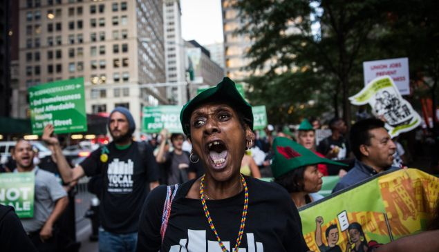 Housing activists march from Zuccotti Park to New York City's City Hall to demand more affordable housing options for the homeless and poor.