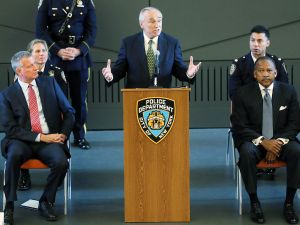 YORK, NY - OCTOBER 08: New York City Police Commissioner Bill Bratton speaks at a Swearing-In ceremony form police officers with New York Mayor Bill de Blasio (L) at the Police Academy on October 8, 2015 in New York City. A total of seven hundred and fifty officers were sworn-in at the event and will take to the city streets following months more of training. Following concerns about excessive force, the New York Police Department recently launched a new program that will force all officers to document and review every physical encounter with the public. (Photo by Spencer Platt/Getty Images)