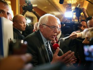 LAS VEGAS, NV - OCTOBER 13: Democratic presidential candidate Sen. Bernie Sanders (I-VT) is interviewed as he leaves the spin rooom after he took part in a presidential debate sponsored by CNN and Facebook at Wynn Las Vegas on October 13, 2015 in Las Vegas, Nevada. Five Democratic presidential candidates are participating in the party's first presidential debate. (Photo by Joe Raedle/Getty Images)