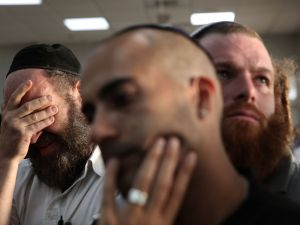 Friends and relatives mourn during the funeral of 51-year-old Israeli Alon Guverg, who was killed a day earlier when Palestinian attackers shot at a bus, in Jerusalem on October 14, 2015. The bus attack was the first assault with a gun in Jerusalem in the two-week-old upsurge of Palestinian violence. AFP PHOTO / GALI TIBBON (Photo credit should read GALI TIBBON/AFP/Getty Images)