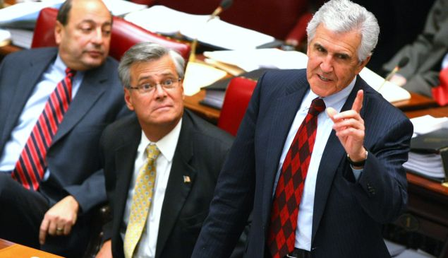 Former Majority Leader Joseph Bruno stands to speak, as future (and now also former) Majority Leader Dean Skelos sits to his left. (Photo by Daniel Barry/Getty Images)