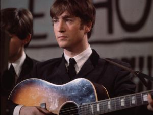 25th November 1963: John Lennon (1940 - 1980), singer, guitarist and songwriter with the Beatles, plays an acoustic guitar during Granada TV's Late Scene Extra television show filmed in Manchester, England on November 25, 1963. (Photo by Hulton Archive/Getty Images)
