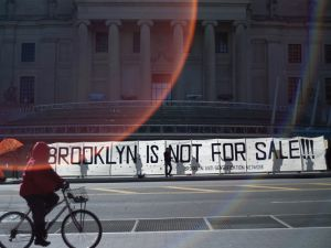 "Artists and activists held signs and banners outside the Brooklyn Museum, with messages like ""BK NOT 4 SALE."" (Photo: Getty Images)"