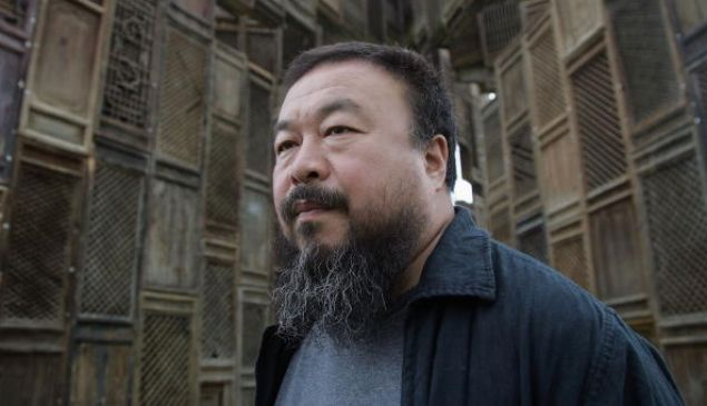 "KASSEL, GERMANY - JUNE 13 Chinese Artist Ai Weiwei poses in front of his sculpture 'Template' during a media preview of Documenta 12 on June 13, 2007 in Kassel, Germany. The Documenta is ""one of the most important exhibitions of modern and contemporary art"" which now takes place every five years in Kassel and will be open to the public June 16 - September 23."