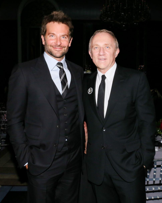 Bradley Cooper Salutes Francois-Henri Pinault at a Solemn Celebration