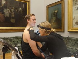 A protestor at the Tate getting tattooed to call attention to dangerous CO2 emissions. (Photo: @liberatetate via Twitter)