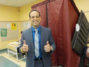 Carmelo Garcia leaves the voting booth on Election Day.