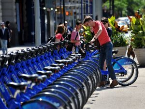 With AFP Story by Brigitte DUSSEAU: US-Transport-Bicycle-Share-CitiBike A couple get their Citi Bike bicycles from a station near Union Square as the bike sharing system is launched May 27, 2013 in New York. About 330 stations in Manhattan and Brooklyn will have thousands of bicycles for rent. AFP PHOTO/Stan HONDA