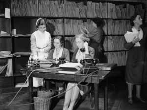 1939: Receptionists taking calls in the appointments department of University College Hospital, London. (Photo by General Photographic Agency/Getty Images)
