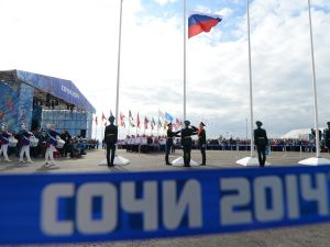 The Russian Federation's national flag (C) is hoisted during the welcoming ceremonies of the delegations ahead of the Sochi Winter Olympics, on February 5, 2014 at the Amphitheatre Square in Sochi. The opening ceremony of the Sochi Olympic Winter will take place on February 7, 2014. AFP PHOTO / ANDREJ ISAKOVIC (Photo credit should read ANDREJ ISAKOVIC/AFP/Getty Images)