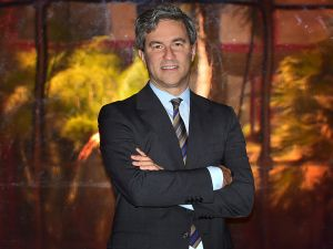 "Michael Govan, Director of the Los Angeles County Museum of Art (LACMA), poses on April 28, 2015 in Los Angeles, California, in front of 'Red Concave Circle' by DeWain Valentine on exhibit at the museum for its 50th anniversary. AFP PHOTO / FREDERIC J. BROWN ""MANDATORY MENTION OF THE ARTIST DEWAIN VALENTINE UPON PUBLICATION"" (Photo credit should read FREDERIC J. BROWN/AFP/Getty Images)"