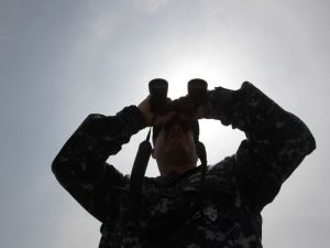 SEOUL, SOUTH KOREA - JULY 06: A U.S. Navy looks binocular during the Combined Joint Logistics Over the Shore (CJLOTS) exercise at the Anmyeon seashore on July 6, 2015 in Taean, South Korea. This exercise will train the South Korea-U.S. service members on how to accomplish vital logistical measures in an area with strategic access to Seoul. Approximately 900 U.S. and 800 South Korea personnel participates in the exercise.