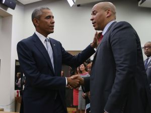 "WASHINGTON, DC - SEPTEMBER 18: (AFP OUT) U.S. President Barack Obama (L) greets Sen. Corey Booker (D-NJ) during a gathering of actors, hip-hip artists, justice activists, state and local elected officials and community leaders advocating for criminal justice reform in the Eisenhower Executive Office Building South Court Auditorium September 18, 2015 in Washington, DC. The leaders gathered for a screening of ""Fixing the System,"" an upcoming special documentary about criminal justice reform. (Photo by Chip Somodevilla/Getty Images)"