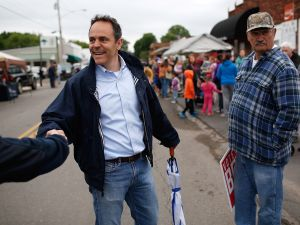 FOUNTAIN RUN, KY - MAY 17: Kentucky Republican senatorial candidate Matt Bevin greets voters at the Fountain Run BBQ Festival while campaigning for the Republican primary May 17, 2014 in Fountain Run, Kentucky. Bevin and Senate Minoriry Leader Mitch McConnell are campaigning heavily throughout the state during the final weekend before the Republican primary to be held May 20. (Photo by Win McNamee/Getty Images)