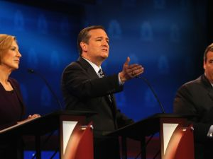 BOULDER, CO - OCTOBER 28: Presidential candidate Sen. Ted Cruz (C) (R-TX) speaks while New Jersey Gov, Chris Christie (R) and Carly Fiorina look on during the CNBC Republican Presidential Debate at University of Colorados Coors Events Center October 28, 2015 in Boulder, Colorado. Fourteen Republican presidential candidates are participating in the third set of Republican presidential debates. (Photo by Justin Sullivan/Getty Images)