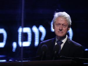 Former president of the United States Bill Clinton delivers his speech during a commemorative rally in memory of late Israeli prime minister Yitzhak Rabin, at Rabin Square in the Israeli coastal city of Tel Aviv on October 31, 2015. The rally is part of commemorations marking the 20th anniversary of Rabin's killing by a right-wing Jewish extremist. AFP PHOTO / THOMAS COEX (Photo credit should read THOMAS COEX/AFP/Getty Images)