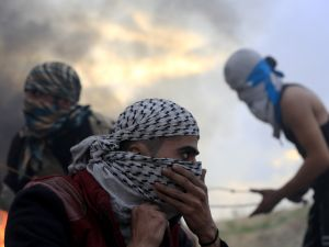 Palestinian protesters are pictured during clashes with Israeli soldiers near the border fence between Israel and the central Gaza Strip east of Bureij on November 6, 2015. Israeli forces shot and killed a Palestinian in the Gaza Strip during clashes along the border, the enclave's health ministry said. AFP PHOTO / MOHAMMED ABED (Photo credit should read MOHAMMED ABED/AFP/Getty Images)