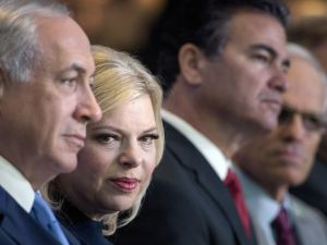 Israeli Prime Minister Benjamin Netanyahu (L) waits with his wife Sara (2L) before addressing the Jewish Federations of North America's 2015 General Assembly November 10, 2015 in Washington, DC. AFP PHOTO/BRENDAN SMIALOWSKI (Photo credit should read BRENDAN SMIALOWSKI/AFP/Getty Images)