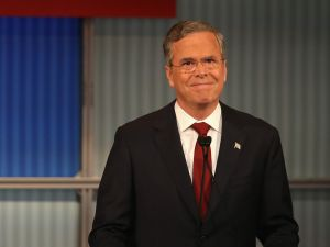 MILWAUKEE, WI - NOVEMBER 10: Republican presidential candidate Jeb Bush smiles during the Republican Presidential Debate sponsored by Fox Business and the Wall Street Journal at the Milwaukee Theatre November 10, 2015 in Milwaukee, Wisconsin. The fourth Republican debate is held in two parts, one main debate for the top eight candidates, and another for four other candidates lower in the current polls. (Photo by Scott Olson/Getty Images)