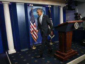 WASHINGTON, DC - NOVEMBER 13: U.S. President Barack Obama departs the White House briefing room after delivering remarks on the recent violence taking place in Paris, France November 13, 2015 in Washington, DC. Gunfire and explosions erupted in the French capital with early casualty reports indicating at least 60 dead. (Photo by Win McNamee/Getty Images)