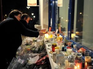 "People light candles outside the Petard Butcher Shop in Chailles, near Blois, central France, on November 17, 2015, to pay tribute to Anna and Marion Petard-Lieffrig, victims of the attacks claimed by Islamic State (IS) on November 13 in Paris. Anna Petard, 26 years old, and her sister Marion, 30 years old, were killed in the restaurant ""Le petit Cambodge"". AFP PHOTO / GUILLAUME SOUVANT (Photo credit should read GUILLAUME SOUVANT/AFP/Getty Images)"