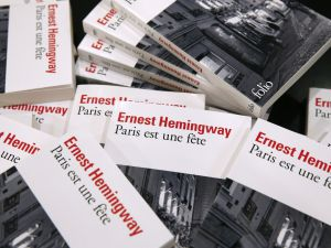 "A photo taken in Paris on November 20, 2015 shows copies of late US author Ernest Hemingway's novel ""Paris est une fete"" (""A Moveable Feast""). US literary great Ernest Hemingway's tender and joyful memoir of 1920s Paris, ""A Moveable Feast"", has enjoyed a surge in sales since last week's terror attacks in the French capital. AFP PHOTO / PATRICK KOVARIK (Photo credit should read PATRICK KOVARIK/AFP/Getty Images)"