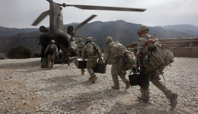 KORENGAL VALLEY, AFGHANISTAN - OCTOBER 27: U.S. soldiers board an Army Chinook transport helicopter after it brought fresh soldiers and supplies to the Korengal Outpost on October 27, 2008 in the Korengal Valley, Afghanistan. The military spends huge effort and money to fly in supplies to soldiers of the 1-26 Infantry based in the Korengal Valley, site of some of the fiercest fighting of the Afghan war. The unpaved road into the remote area is bad and will become more treacherous with the onset of winter. (Photo by John Moore/Getty Images)
