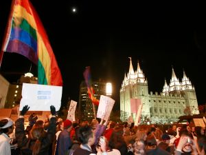 SALT LAKE CITY, UT - NOVEMBER 7: Thousands of people protest against the passage of California's Proposition 8 outside the world headquarters of Temple of the Church of Jesus Christ of Latter Day Saints November 7, 2008 in Salt Lake City, Utah. The protesters were marching against the Mormon church's support for the ballot measure that passed on November 4 making gay marriage illegal. (Photo by George Frey/Getty Images)