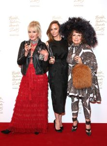 Presenters Patsy Stone and Eddy Monsoon with Stella McCartney OBE, winner of Brand of the Year (Photo: Mike Marsland, British Fashion Council)