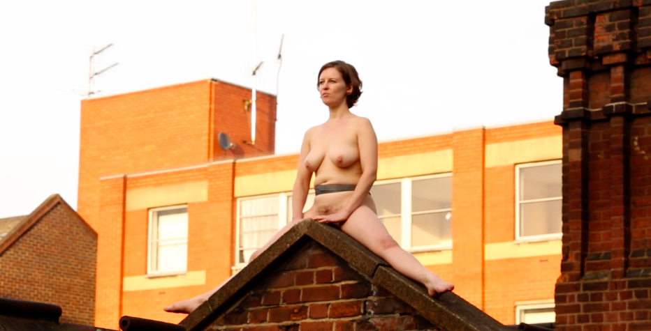 Why Did This Naked Artist, Joined by a Squirrel, Sit on a Rooftop for 4 Hours?