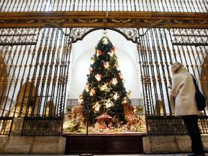The Met's 20-foot blue spruce is adorned with 50 suspended angels and is on display in the museum's Medieval Sculpture Hall. (Mario Tama/Getty Images)