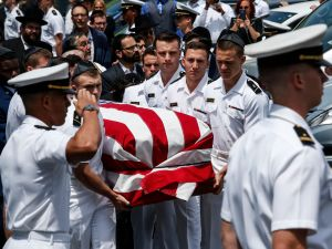HEWLETT, NY - MAY 15: Midshipmen from the U.S Naval academy carry Midshipman Justin Zemser to a waiting car after his funeral on May 15, 2015 in Hewlett New York. Zemser was one of eight people who were killed in the derailment of an Amtrak train on May 12th in Philadelphia. (Photo by Kena Betancur/Getty Images)