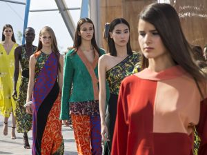 Models present creations from the Jonathan Saunders collection during the Spring / Summer 2016 London Fashion Week in London on September 20, 2015. AFP PHOTO / JACK TAYLOR (Photo credit should read JACK TAYLOR/AFP/Getty Images)
