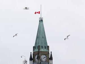 The Canadian flag flies at half-mast over the Parliament Buildings on November 14, 2015 in Ottawa, one day after the terrorist attacks in Paris. Canadian Prime Minister Justin Trudeau expressed solidarity with France after a wave of deadly attacks in Paris left at least 129 people dead. AFP PHOTO / Patrick Doyle (Photo credit should read PATRICK DOYLE/AFP/Getty Images)