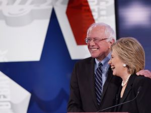 Democratic Presidential hopefuls Hillary Clinton and Bernie Sanders hug after the second Democratic presidential primary debate in Iowa. (Photo: MANDEL NGAN/AFP/Getty Images)