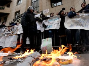 Protesters hold placards and shout slogans as they take part in an anti-Turkey picket outside the Turkish embassy in Moscow (KIRILL KUDRYAVTSEV/AFP/Getty Images)