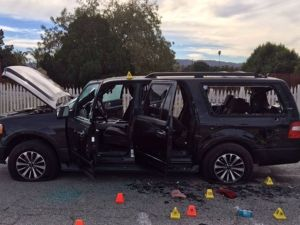 SAN BERNARDINO, CA - DECEMBER 4: (EDITORS NOTE: Best quality available) In this handout photo provided by the San Bernardino County Sherrif's Department, evidence markers are scattered around an SUV near the site of a shootout between police and suspects in the San Bernardino shootings, December 4, 2015 in San Bernardino, California. Police continue to investigate a mass shooting at the Inland Regional Center in San Bernardino that left at least 14 people dead and another 17 injured on December 2nd. (Photo by San Bernardino County Sherrif's Department via Getty Images)