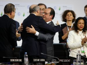 Foreign Affairs Minister and President-designate of COP21 Laurent Fabius (2-L) and France's President Francois Hollande (C) hug after the adoption of a historic global warming pact at the COP21 Climate Conference in Le Bourget, north of Paris, on December 12, 2015. Envoys from 195 nations on December 12 adopted to cheers and tears a historic accord to stop global warming, which threatens humanity with rising seas and worsening droughts, floods and storms. AFP PHOTO / FRANCOIS GUILLOT / AFP / FRANCOIS GUILLOT (Photo credit should read FRANCOIS GUILLOT/AFP/Getty Images)