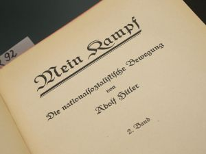 "BERLIN, GERMANY - DECEMBER 15: A 1927 edition of Adolf Hitler's ""Mein Kampf"" (""My Struggle""), volume two, lies at the library of the Deutsches Historisches Museum (German Historical Museum) on December 15, 2015 in Berlin, Germany. The state of Bavaria took possession of the copyright to the book after World War II, though the copyright is due to expire and the book will enter the public domain on January 1, 2016. Germany will continue to heavily restrict publication of the book in Germany though it will have little control over publications abroad. Hitler wrote the book that is both an autobiography and also presents his political vision while he was a prisoner in Germany in he 1920s. (Photo by Sean Gallup/Getty Images)"
