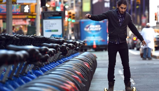 Whizboard Store manager 'Mor Loud' demonstrates the Hoverboard on Broadway in Times Square December 15, 2015. (Photo: TIMOTHY A. CLARY/AFP/Getty Images)