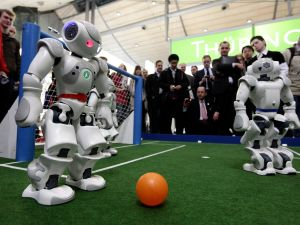Robots play football in a demonstration of artificial intelligence. (Photo: Sean Gallup/Getty Images)