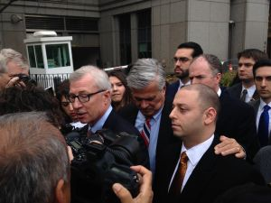 Former State Senate Majority Leader Dean Skelos and his son Adam leave court after being found guilty.