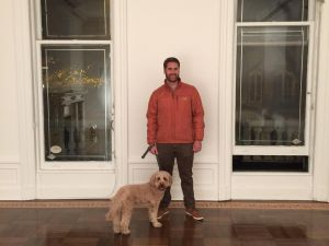 "Harper Levine's brother and his ""goldendoodle"" in his new Upper East Side space. (Photo: Courtesy of Harper's Books)"